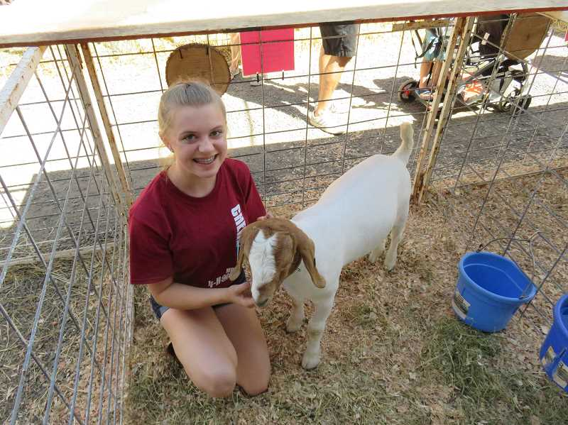 COURTESY SHERWOOD 4-H - Audrey Jeans poses with her goat Smokey at this year's Washington County Fair.