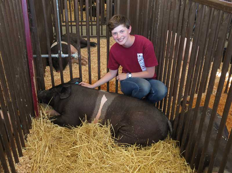 COURTESY OF SHERWOOD 4-H. - Maddie Jeans shows off her pig Theodore.