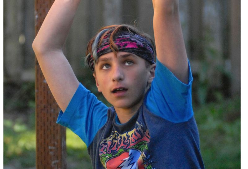 OUTLOOK PHOTO: MATT RAWLINGS - Caiden Madzelan trains on an obstacle set his family built in their backyard. He placed fifth at the age group nationals last week.