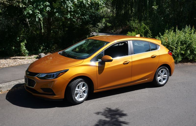 PORTLAND TRIBUNE: JEFF ZURSCHMEIDE - On the road, the Cruze is fun to drive. You've got enough power to merge onto the freeway with confidence, and the compact Cruze makes parking lot navigation a breeze.