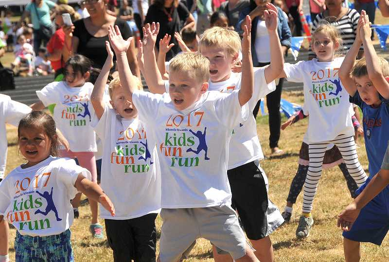 SPOKESMAN PHOTO: VERN UYETAKE  - Kiwanis Fun Run participants warm up before their race. The event was created to promote physical activity and fun.