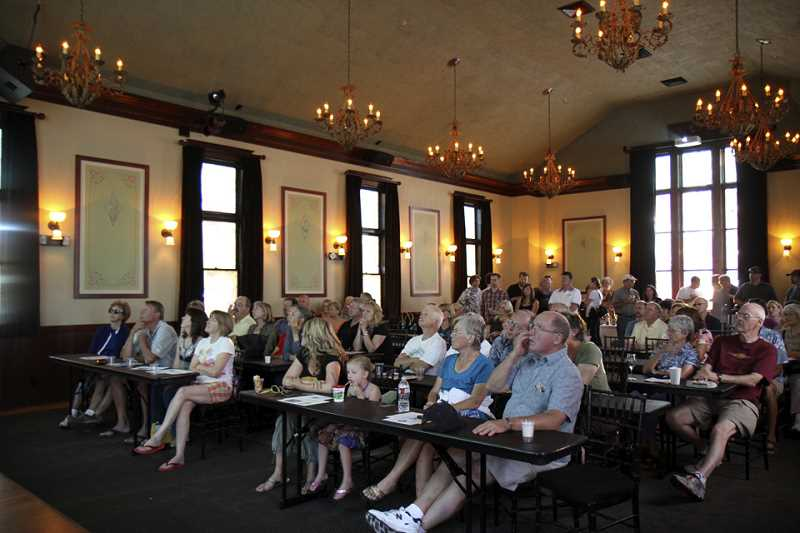 SUBMITTED PHOTO  - The crowd at the History Pub learns about Oregon's history in the Wilsonville McMenamins' Old Church building.