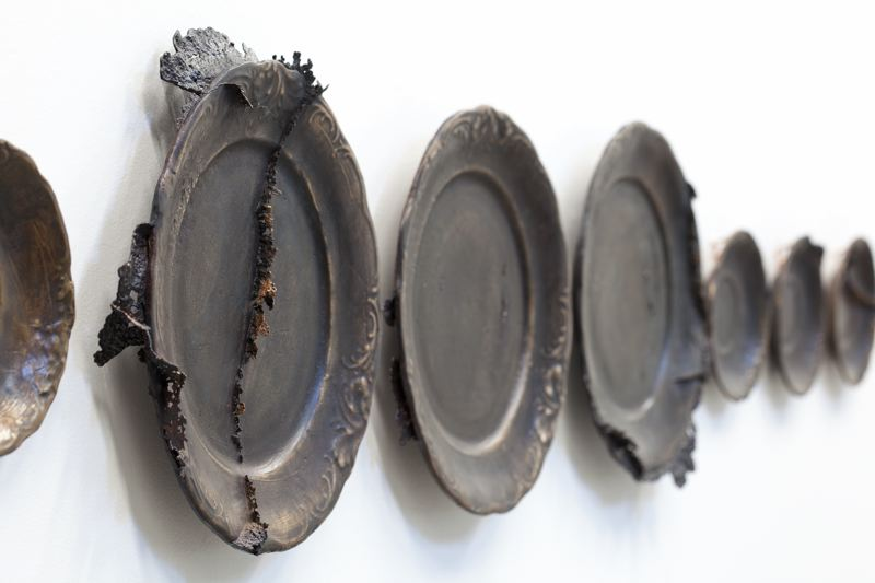 SUBMITTED PHOTO - These bronze cast dishes are part of an exhibition by Kate Simmons at Clackamas Community College.