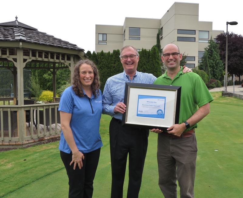 SUBMITTED PHOTO - Alison Hopcroft, head of the state well-being improvement initiative, presents the Blue Zones Project Approved Worksite award to Willamette View CEO Craig Van Valkenburg and David Kohnstamm, Willamette View director of wellness.