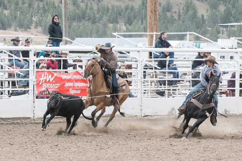 LON AUSTIN/FOR THE PIONEER - Coy Aldrich and Chase Buchanan, seen here competing at the June OHSRA finals rodeo in Prineville, bounced back from a no score July 18 to record a time of 6.52 seconds in the second go-round two days later. Their average score placed them 30th in the overall standings out of 93 teams.