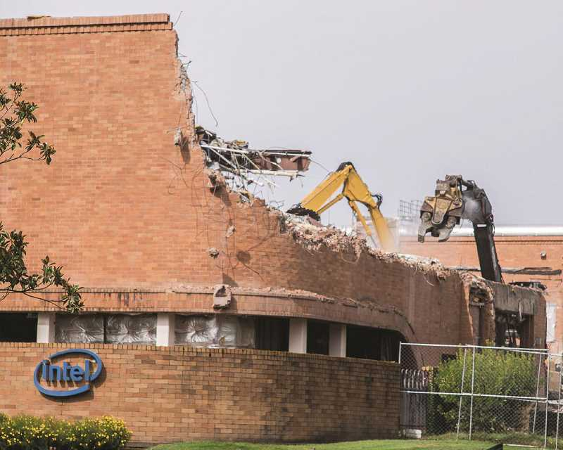 HILLSBORO TRIBUNE FILE PHOTO: NANCY TOWNSLEY - Intels oldest Oregon building, Fab 4, was torn down in 2016 after sitting empty for two decades. Intel remains the countys largest private employer, though Providence Health and Services has taken the crown as the states largest private employer.