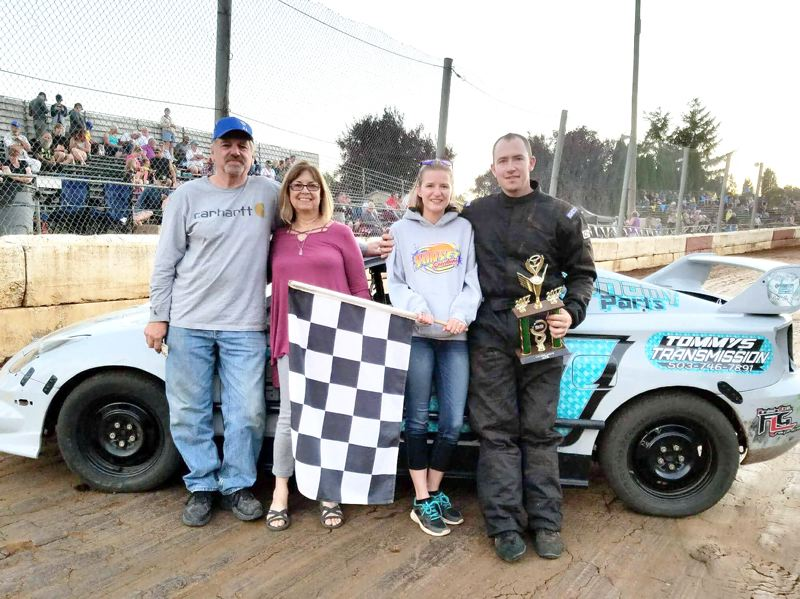 PHOTO COURTESY: TJ WEGNER - TJ Wegner, right, celebrates his second Columbia County Racing Association four-cylinder win in a row with, from left, Dick Gaboury, Linda Williams and Shelby Wegner on Saturday, July 29, at the River City Speedway in his native St. Helens.