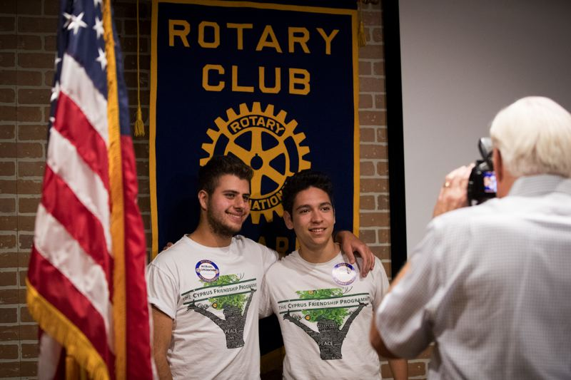 TIMES PHOTO: JAIME VALDEZ - Andreas Constantinou and Hilmi Arica, visiting from Cyprus as part of the Cyprus Friendship Program, pose for a picture after a Tigard Rotary luncheon at Nicoli's Grill & Sports Bar.