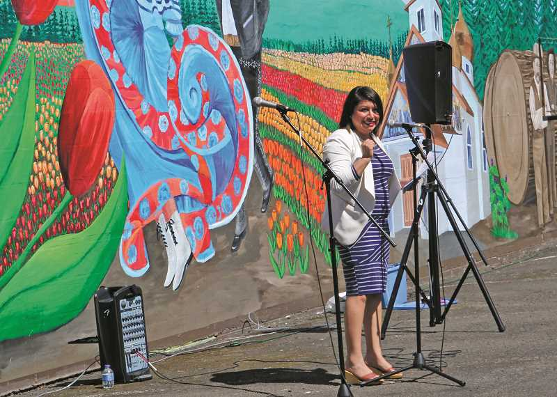 INDEPENDENT PHOTO: JULIA COMNES - Rep. Teresa Alonso Leon, D-Woodburn, spoke at the ribbon-cutting ceremony for the new mural located in downtown. She said the mural represents the Woodburn community's diversity and unity.