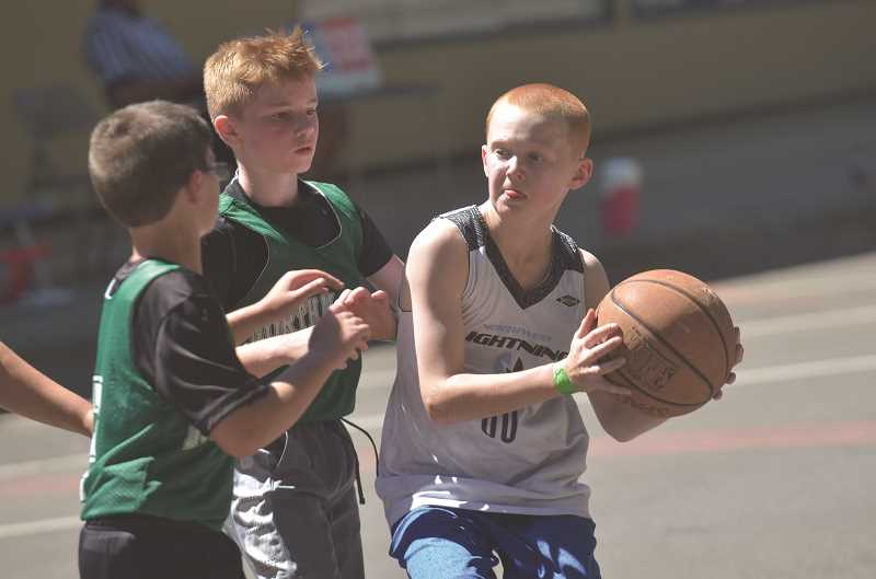HERALD PHOTO: COREY BUCHANAN - The annual Nothing But Net 3-on-3 basketball tournament was held at Wait Park in Canby Saturday, July 29.