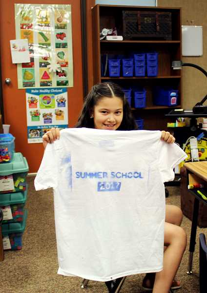 PIONEER PHOTO: KRISTEN WOHLERS - Student Jaretzy Ocegueda shows off the t-shirt she made during summer school.