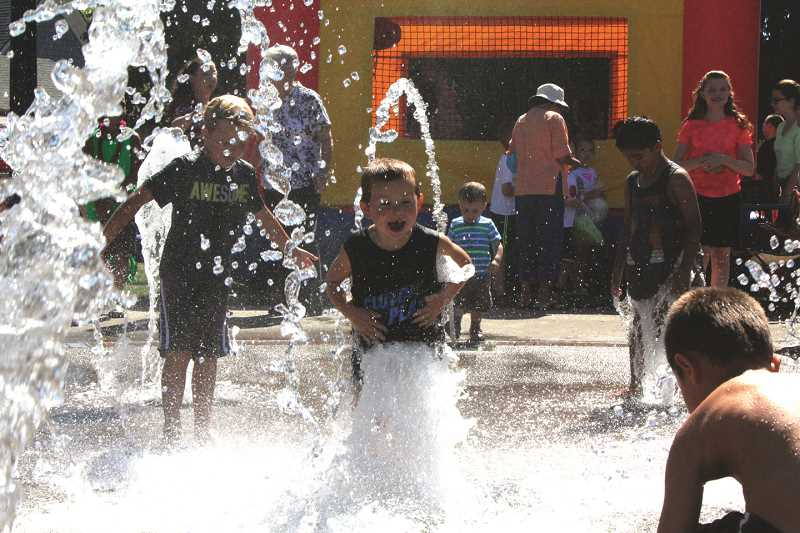 FILE PHOTO - One way to beat the heat this week is to enjoy the splash pads in Woodburn's Centennial Park and Hubbard's Rivenes Park (pictured).
