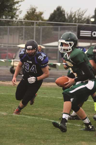 INDEPENDENT FILE PHOTO - Woodburn and North Marion were conference foes for 19 years in the former Capital Conference and for 16 years in the '50s and '60s. The two schools would revive their rivalry if placed in the Tri-Valley Conference as is currently proposed by the OSAA Classification and Redistricting Committee.