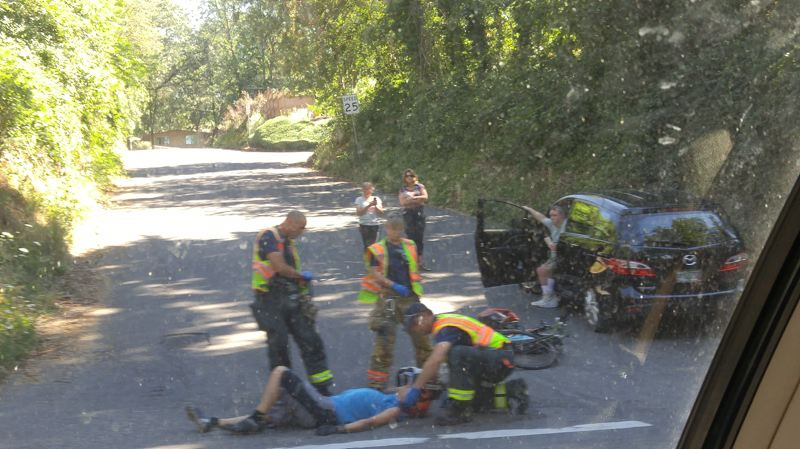 SUBMITTED PHOTO - A bicyclist can be seen talking with paramedics near the intersection of Oatfield Road and McNary Road in Oak Grove.