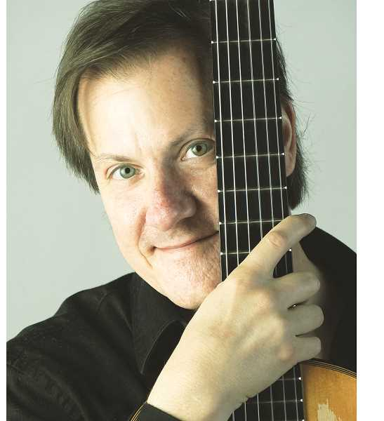 SUBMITTED PHOTO - David Rogers, a Eugene-based guitarist and composer, will once again perform at The Coffee Cottage, 808 E. Hancock St., Aug. 11, bringing with him a wide-ranging repertoire of classical pieces, original compositions and arrangements of popular contemporary songs.
