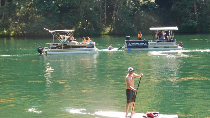 ESTACADA NEWS PHOTO: EMILY LINDSTRAND - The River Hip Hop Fest brought artists to play on party barges at Promontory Park. Many people listened from boats or stand up paddle boards.