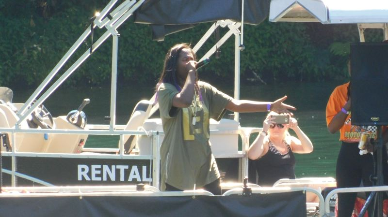 ESTACADA NEWS PHOTO: EMILY LINDSTRAND - Hip hop artist [E]mpress performs from a party barge during the River Hip Hop Fest last weekend.
