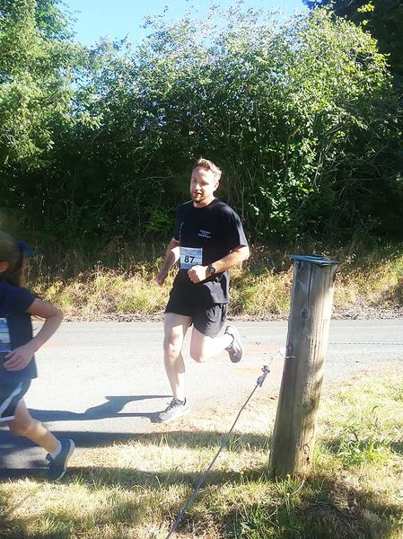 PHOTO CREDIT: RALPH PAINTER MEMORIAL 10K, 5K AND KIDS RACE - Andy Wedam, 40, of Battle Ground, Wash., makes a turn in the Ralph Painter Memorial 5k.