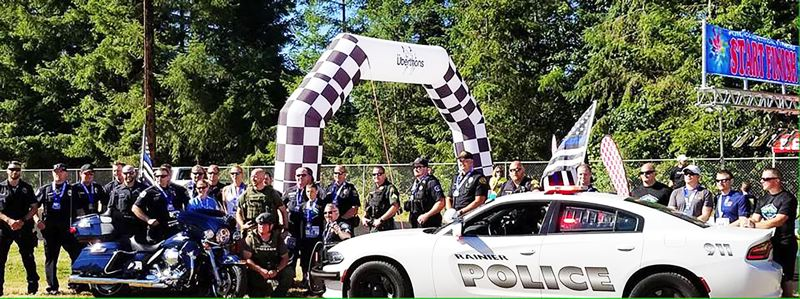 PHOTO CREDIT: RALPH PAINTER MEMORIAL 10K, 5K AND KIDS RACE - The Rainier Police Department joined forces with law enforcement personnel from around the area to run the kids race in full service gear.