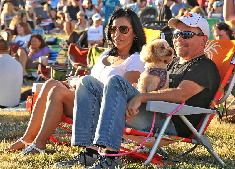 Lydia Hartley, Jim Bobbett and his dog Daisy enjoy the concert.