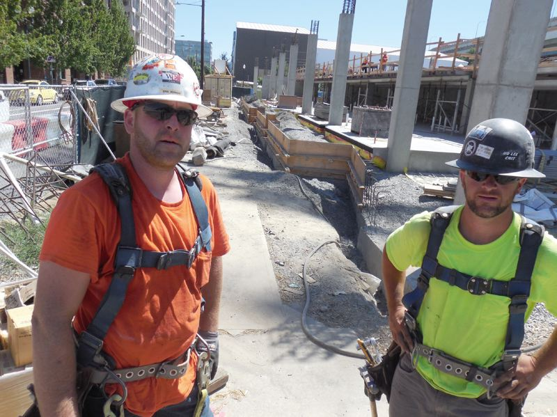 PAMPLIN MEDIA GROUP: JOSEPH GALLIVAN  - Carpenters Kris Meining and Josh Phelps with Marion Construction of Clackamas are not worried about temperatures goign into the triple digits as they work on concrete forms at 1411 N.W. Quimby St. in the Pearl District. Were building America, says Meining.