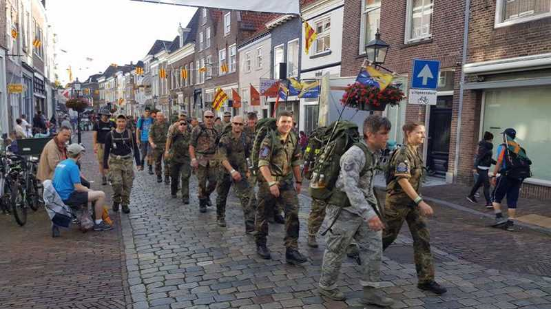 SUBMITTED PHOTO - Tech Sgt. Fox, in lead at left, marches through the town of Nijmegen, Netherlands.