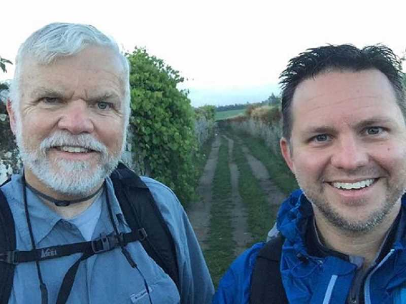 SUBMITTED PHOTO: THE CATHOLIC SENTINEL - Fr. Jeff Eirvin, right, director of vocations for the Archdiocese of Portland, and his father, Jeff Eirvin Sr., pose for a photo on the path of Camino de Santiago this July. The two completed the 150-mile pilgramage in ten days.