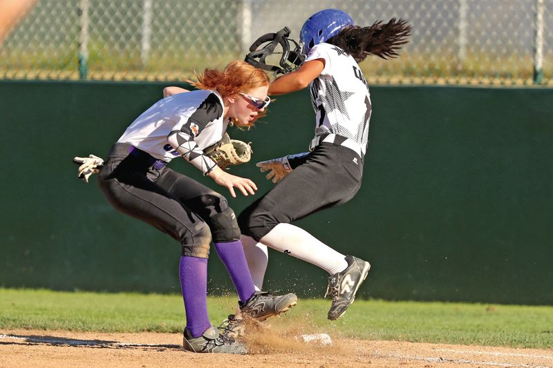 TIMES PHOTO: JAIME VALDEZ - South Beaverton first baseman Hailey Stutzman catches a ball at the bag and absorbs a big hit from a Tualatin/Tigard City base runner in the District Four Championship.