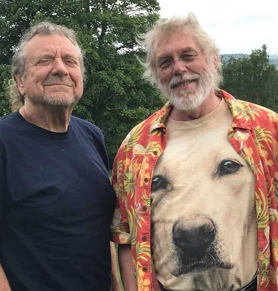 SUBMITTED PHOTO: KENT NERBURN - Kent Nerburn (right) poses with legendary musician Robert Plant at the Hay Festival in Wales on June 4.
