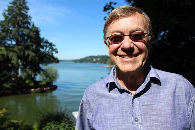 REVIEW PHOTO: SAM STITES - Michael Bosworth poses in the backyard of his home on Oswego Lake. The high-tech-CEO-turned-musician and his family have lived in Lake Oswego for more than 40 years.