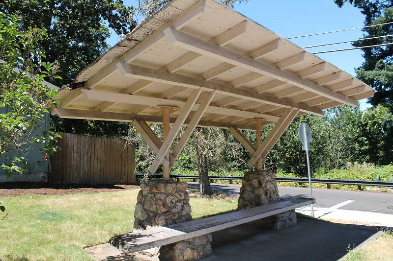 REVIEW PHOTO: ANTHONY MACUK - The Hallinan Heights Neighborhood Association received a $4,700 grant to rehabilitate a school bus shelter at the intersection of Hallinan and Laurel streets.
