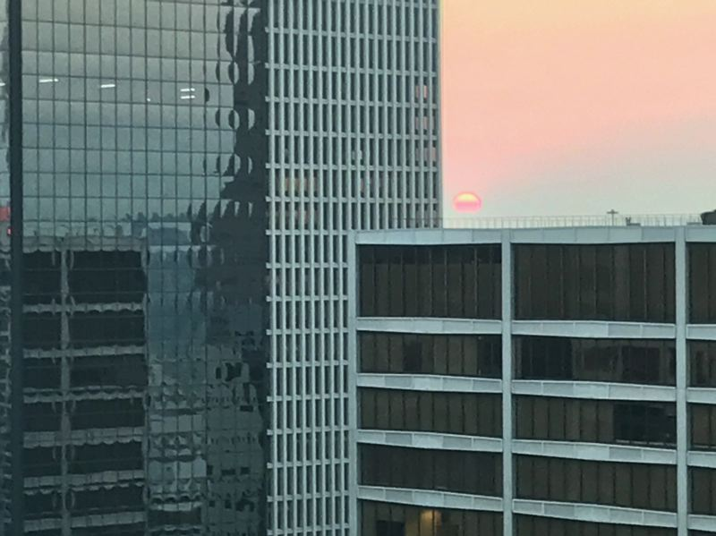 TIMES PHOTO: DANA HAYNES - The sun rose as a deep red sphere Thursday and Friday mornings over Portland, thanks to smoke particulate in the air coming from forest fires in Washington and Canada.