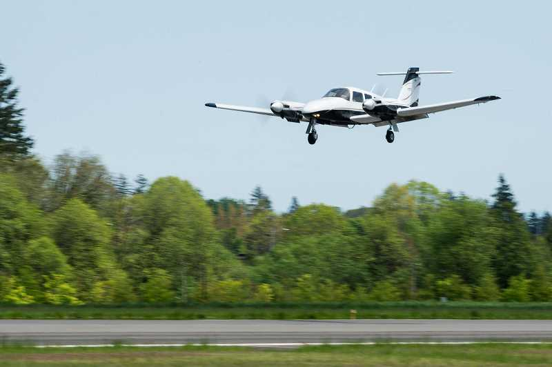 HILLSBORO TRIBUNE PHOTO: CHRISTOPHER OERTELL - An airplane prepares to land on the main runway at Hillsboro Airport earlier this year. A second runway allows the airport to cut down on delays in the air, but the runway was challenged in court.