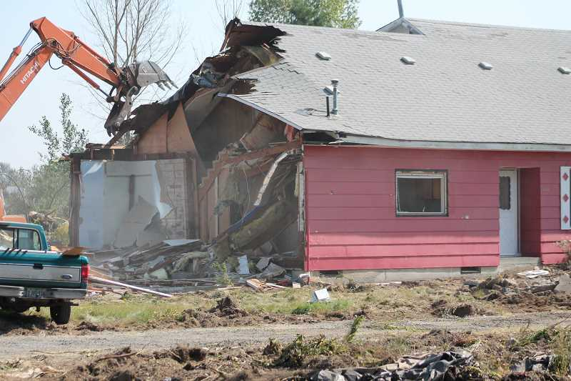 PIONEER PHOTO: CONNER WILLIAMS - This home, formerly located at 1009 Toliver Road, was demolished this week to make room for 11 units of the Twin Meadows Estates subdivision, a 30-lot project that is now underway.