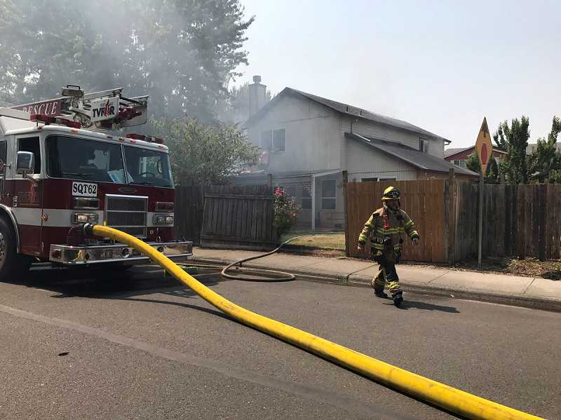 PHOTO COURTESY OF TUALATIN VALLEY FIRE & RESCUE. - Firefighters respond to a house fire on Aug. 3 in Aloha.