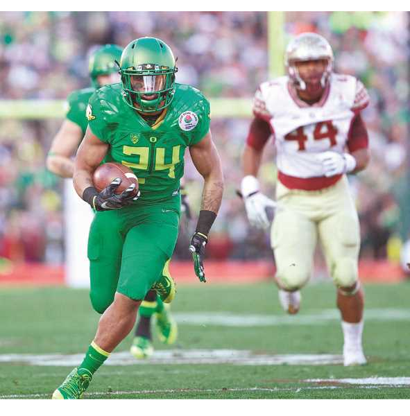 PORTLAND TRIBUNE FILE PHOTO - Thomas Tyner carries the ball for the Oregon Ducks during the Rose Bowl versus Florida State. The former Aloha Warrior will be playing this season for the Oregon State Beavers.