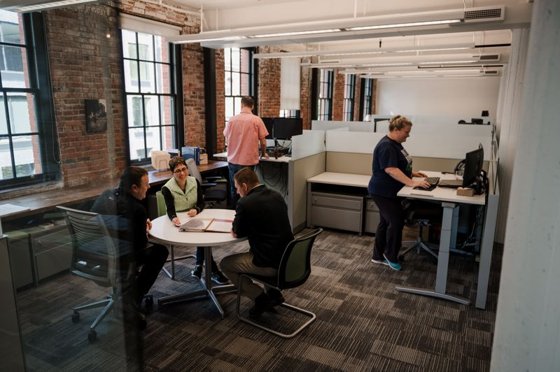 SUBMITTED: MORTENSON - The outside edges of the office are open workstations so everyone gets to take advantage of natural light, with the private offices in the center of the building.
