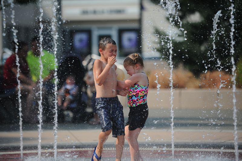 OUTLOOK PHOTO: JOSH KULLA - This splash pad in Gresham is another great way to keep cool.
