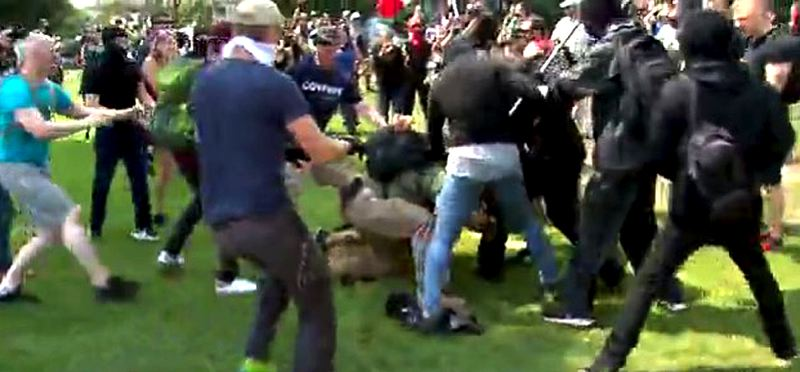 COURTESY PHOTO: KOIN 6 NEWS - Fights broke out and pepper spray flew as two competing groups held rallies Sunday afternoon, Aug. 6, in Waterfront Park. Three people were arrested during the rallies, which were mostly peaceful.