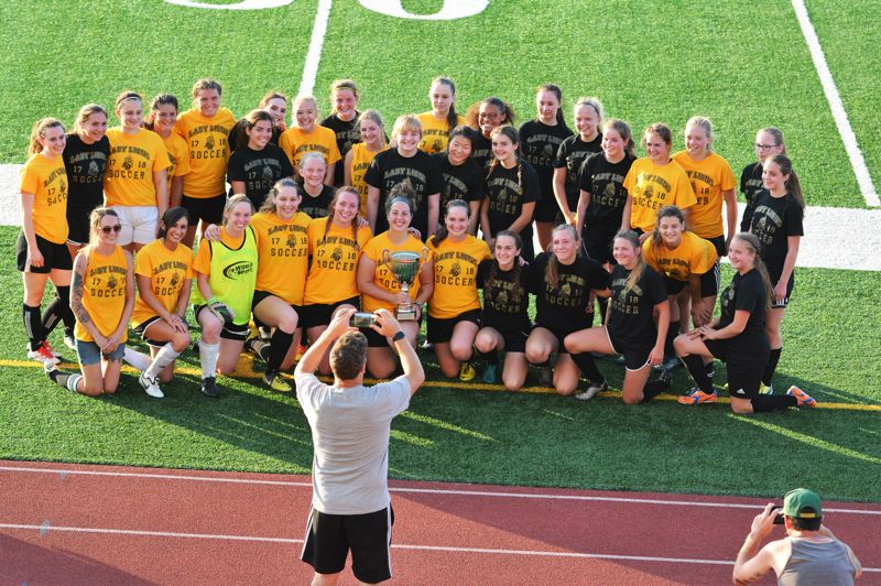 SPOTLIGHT PHOTO: JAKE MCNEAL - St. Helens girls' soccer coach Simon Date, center, takes a photo of the Alumni, dressed in yellow, and the Preps, in black.