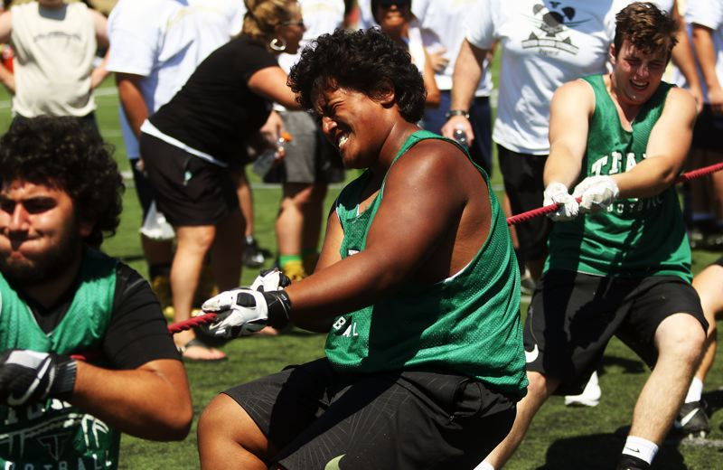 DAN BROOD - The Tigard High School linemen, including senior-to-be Layton Tanuvasa (center), dominated in the tug-of-war at the Metro Area Lineman Challenge.