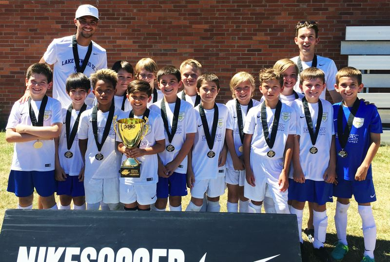 SUBMITTED PHOTO - The LOSC U11 Elite boys soccer team poses with its trophy after winning the Nike Cup. The team includes (front row, left to right) Dominic Lemuz, Enzo Morse, Dario White, Tristan Peia, Luca Bolouri, Wyatt Murchinson, Ryder Lemm, Hudson Gasperson, Pablo Spilk and Cooper Wyngarden, and (back row) coach Lucas dePinna, Jackson Hartley, Leo Novack, Sullivan Kirtz, Jack Csaszar and coach Louie Jones.