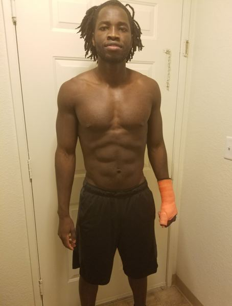 Former George Fox football player Samuel Wani sports a cast on his left hand following surgery.