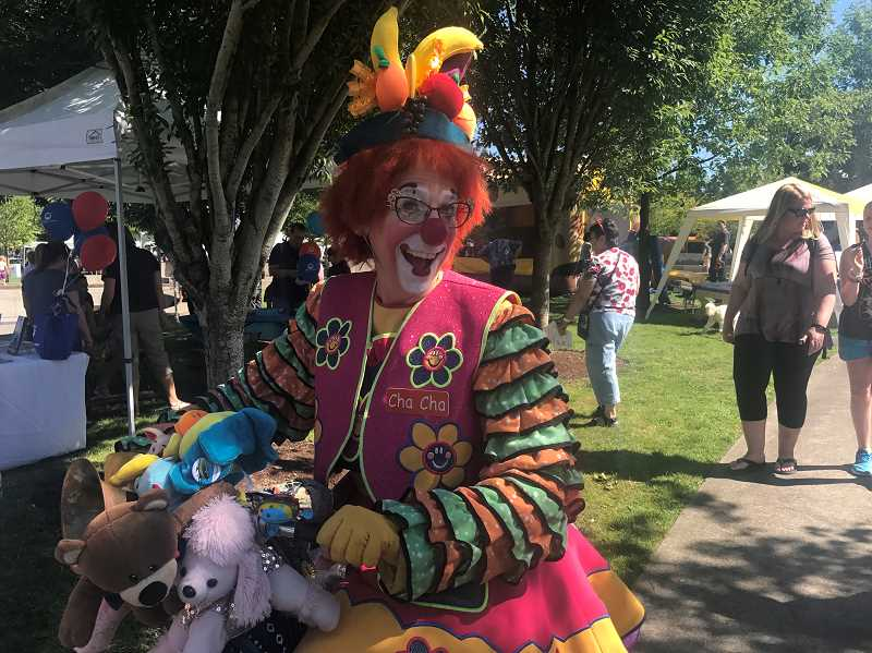 SPOKESMAN PHOTO: MADISON STATEN - Cha Cha the clown entertains visitors at Fun In the Park on her bicycle.