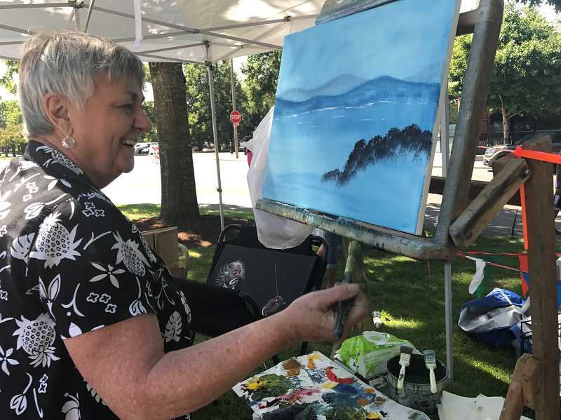 SPOKESMAN PHOTO: MADISON STATEN  - Judy Stoug paints live for visitors at Fun in the Park.
