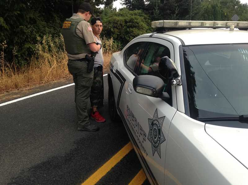 CLACKAMAS COUNTY SHERIFF'S OFFICE - Phillip Garrett Dominguez being arrested by Clackamas County Sheriff's officials on the morning of Aug. 7, 2017.