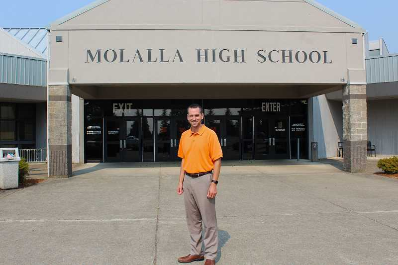 PIONEER PHOTO: KRISTEN WOHLERS - Brad Berzinski has taken over as the principal at Molalla High School after relocating from Winona, Minnesota.
