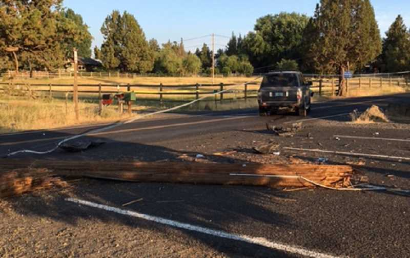 PHOTO COURTESY OF DESCHUTES COUNTY SHERIFF'S OFFICE - The wreck closed the roadway for two hours as power lines were cleared from the area.