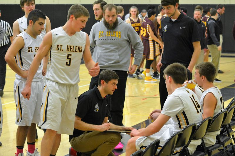 SPOTLIGHT PHOTO: JAKE MCNEAL - Second-year Lions boys' basketball coach Jordan Massinger, center, will depart from St. Helens High as he becomes a fifth-grade teacher at Chinook Elementary School in Vancouver, Wash., this fall.