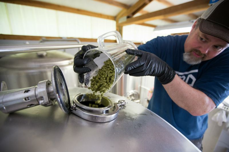 COURTESY PHOTO - Owner/brewmaster Rick Strauss looks over his ingredients at Bent Shovel Brewing. He says local residents are big on Oregon City breweries, as are outdoor adventurers who come to play on the Clackamas River.